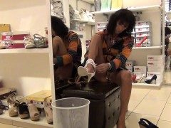 horny-woman-in-a-shoe-store-can-t-wait-to-flash-her-ass-and