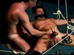 Muscular Dude Is Gagged And Restrained While His Balls Are