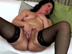 black-haired-mature-fingering-herself-in-stockings