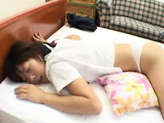 asian-schoolgirl-lies-on-her-stomach-showing-her-ass-to-her