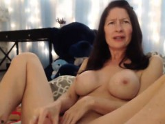 beauty-mature-plays-with-her-pussy-and-squirts-hard