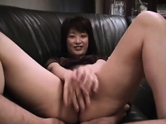 asian fingering her hairy cunt