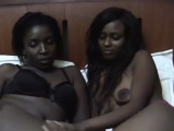 Two very hot ebony lesbian babes are in their bedroom