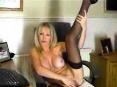 stunning-older-woman-plays-with-dildo