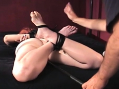 Tightly Tied Wench Gets Her Cunt Thoroughly Examined