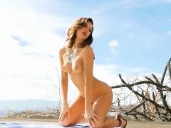 amazing-american-brunette-strips-of-her-tiny-bikini