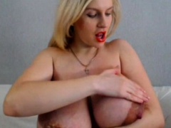 busty-blue-eyed-babe-shows-off-her-big-round-boobs-on-webcam