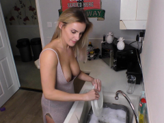 Beautiful busty blonde washing the dishes with downblouse
