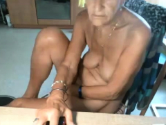 blonde-granny-masturbate-on-the-chair-in-livingroom