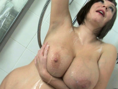 roxy-anderson-soaps-up-her-giant-tits-and-round-ass