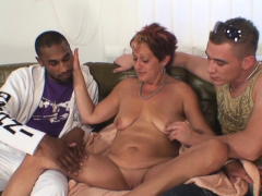 sexy-grandma-swallows-black-and-white-cocks-at-once