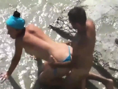 kama-sutra-couples-nude-beach-back-position-3