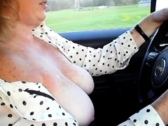 girl-driving-around-town-with-tits-out