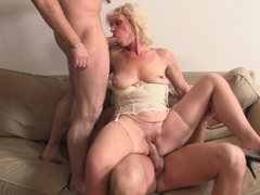 cute blonde grandma enjoys hot threesome