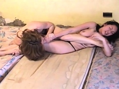 catfight-aggressive-topless-catfight-with-biting-face