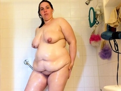 sexy-bbw-milf-big-boobs-wet-and-lathered-with-soap-in-the-sh